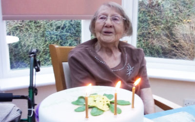 Lady resident with her birthday cake
