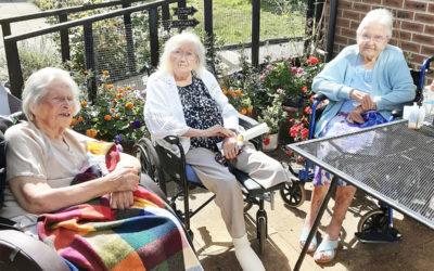 Residents at Loose Valley Care Home enjoy outdoor coffee morning