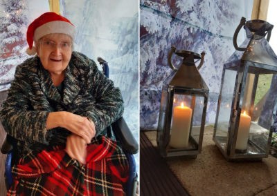 Resident in a Santa hat outside in a festive market at Loose Valley Care Home