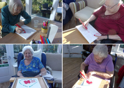 Loose Valley residents colouring poppy pictures
