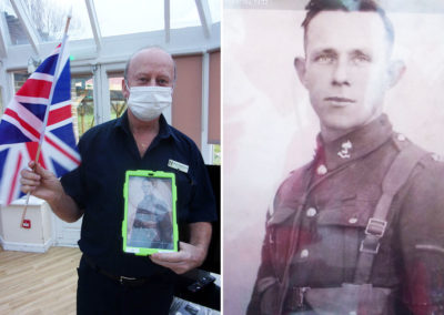 Staff member at Loose Valley Care Home with a wartime photo of his father