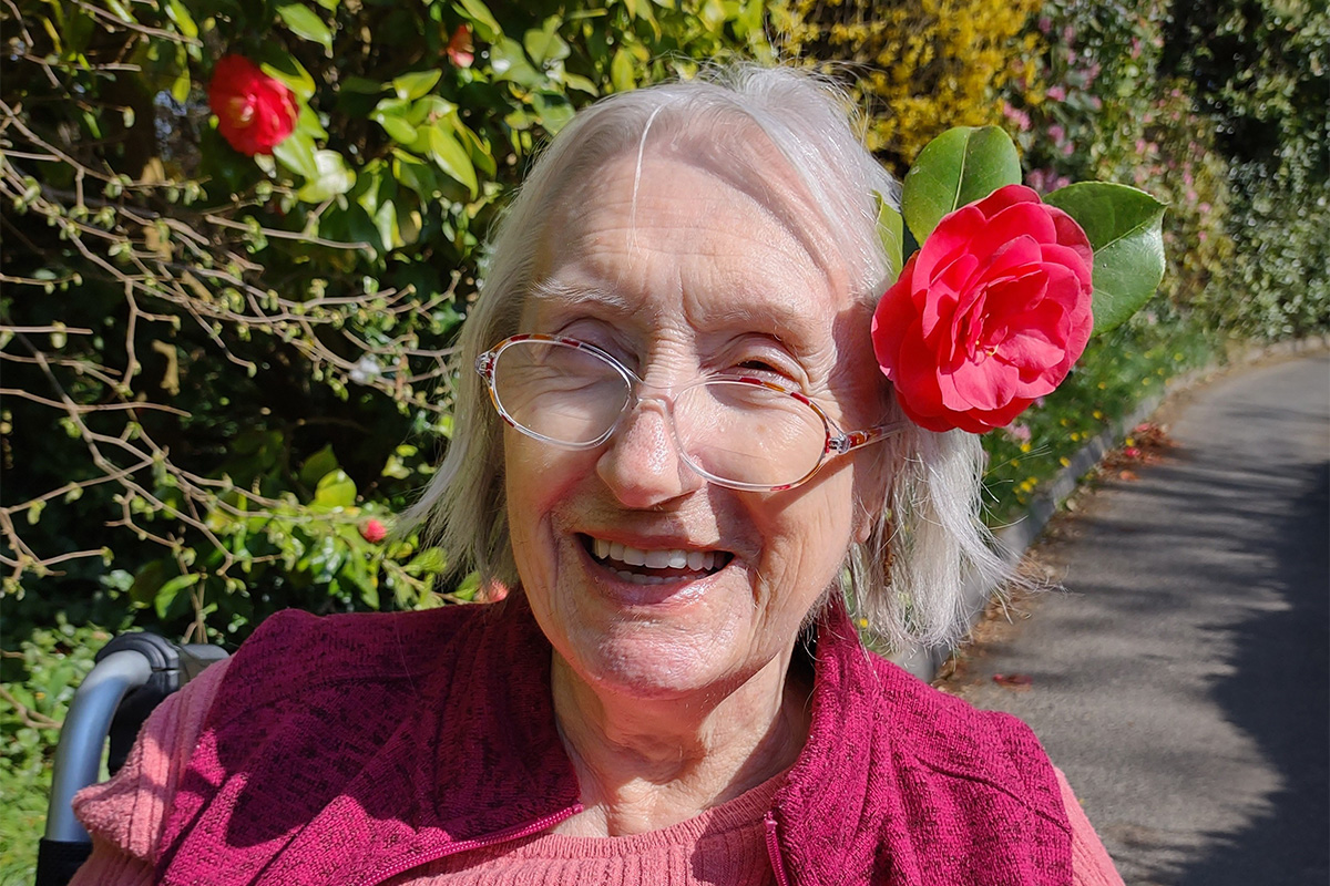 Jean enjoys the sunshine and flowers at Loose Valley Care Home